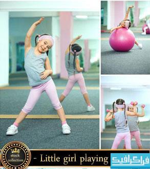 تصاویر استوک دختر بچه در حال ورزش کردن