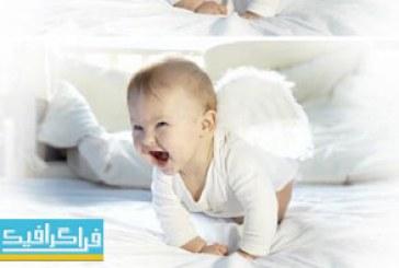 دانلود ویدیو فوتیج کودک با بال فرشته روی تختخواب